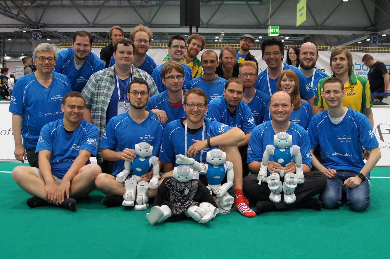 Group picture of the Nao Team HTWK Leipzig with their roboter soccer