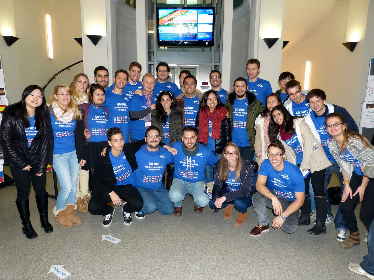 Group picture of incoming students all dressed in blue GO OUT! T-Shirts